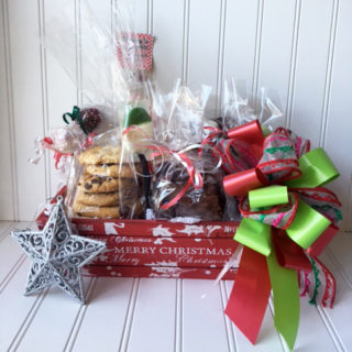 Merry Christmas Box features a wooden painted tray filled with a variety of treats.
